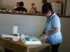 Annie Hinojos cutting cake