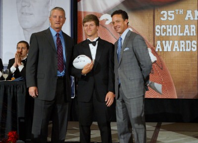 Zach Glaess (center) with QC asst. coach Mark Swartz (left) and AZNFF Awards' host Kevin Ray (right).