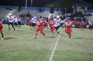 John Ruiz looks for a block against the Florence defense