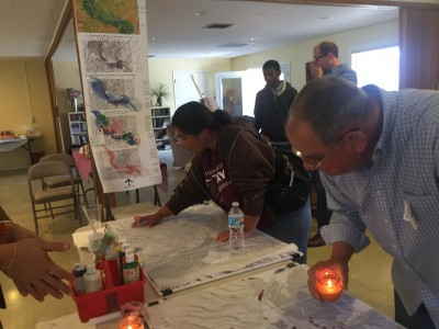 Dropping candle wax on a map of the fire destroyed area as an exercise in planning.