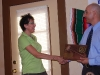 Benny presents a plaque to Kathleen Debiak for her service as President