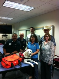 In attendance were, from left, Mark Gomez, AJFD; Chief Monahan, AJPD; Chief Bourgeois, AJFD; Chip Wilson, AJ City Council and Superstition Horsemen's Association; Front Row:Marie Peck, The FETCH Foundation; Maxine Brown, Volunteer Paws and Claws Care Center; and Special Guest:Emma, Service Hero in Training. (Submitted photo)