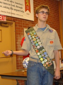Alec Newman tells Knights of Columbus some of the many local Boy Scouts activities.
