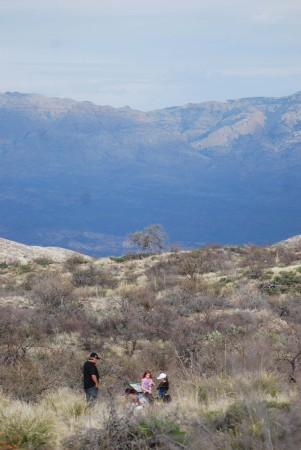 A family hikes on one of the nature trails at Oracle State Park.