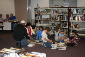 Youngsters looking for books in the children section at the San Manuel Library book sale.