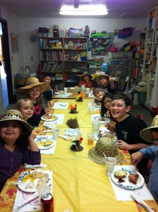 Students and teachers at the Sierra Oaks Community School last week celebrated Thanksgiving a day early. The older children helped serve the dinner to the younger students and families before sitting down and enjoying their own meal in what has become an annual event for the school. (Submitted photos)