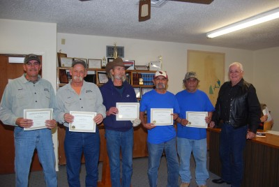 Mammoth Mayor Don Jones, far right, presents certificates of appreciation to town volunteers.