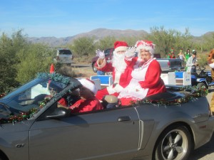Santa arrived via helicopter to the delight of all the children of Copper Basin. He landed on the Ray football field and made his way via Bill Loehr's one-horse open sleigh (AKA Bill's Ford Mustang convertible) to the School Ramada where children young and – ahem – not so young told him their holiday wishes.